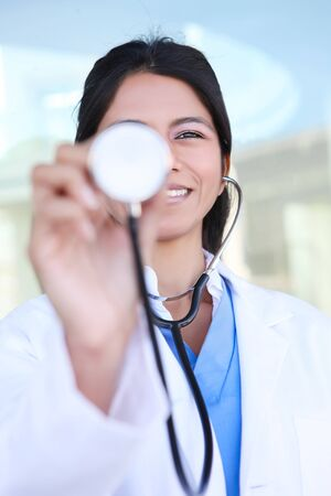 A pretty Indian woman nurse at hospital with stethoscope photo