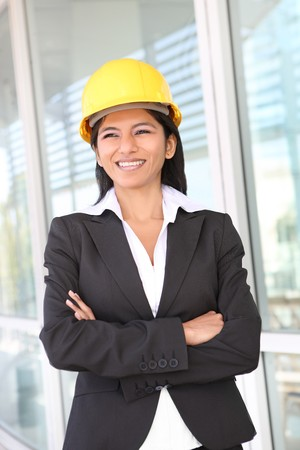 A pretty woman architect on the building construction site   photo
