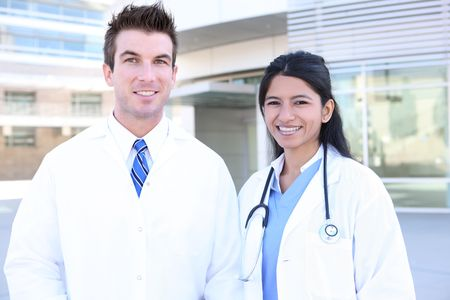Hansome man doctor and woman nurse outside hospital