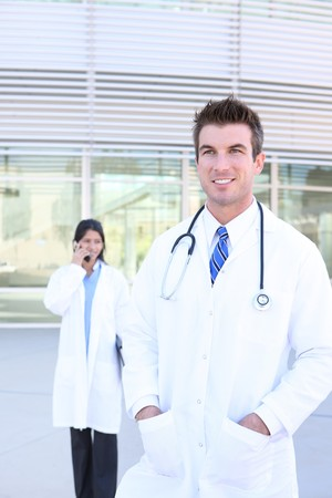 An handsome doctor with woman coworker nurse in background photo