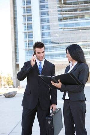 Ethnic man and woman business team at office building Stock Photo - 8244861