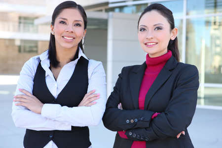 A pretty diverse young business woman team at office building Stock Photo - 8244877
