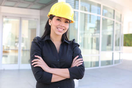 A young pretty hispanic woman architect with at building work site photo