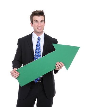 A business man holding a green arrow up indicating success photo