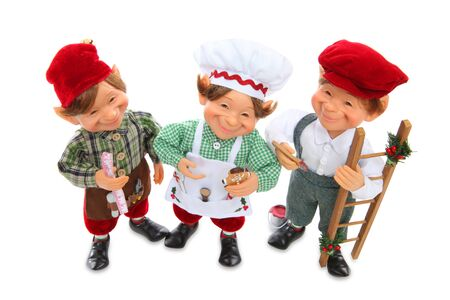 Cute young happy Christmas elves working at Christmas over white photo