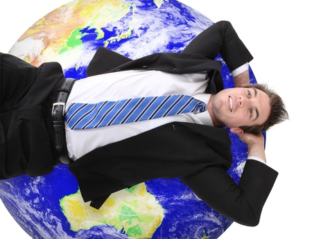 A handsome young business man resting on global earth