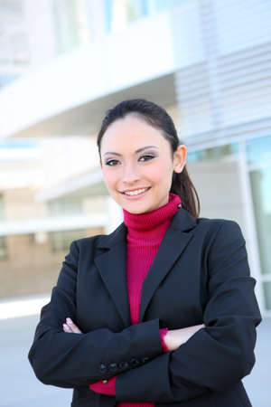 Pretty young caucasian business woman smiling at office building Stock Photo - 8505678