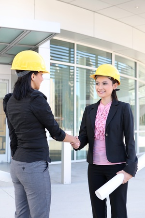 A pretty business women handshake doing construction at office building photo
