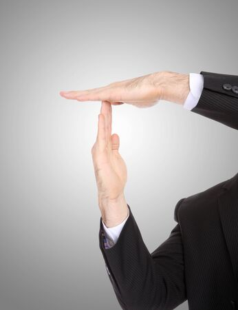 A business man signaling time-out with hands photo