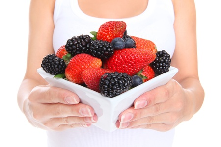 A woman holdng fresh delicious strawberries and blackberries photo