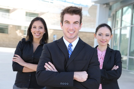 A diverse attractive man and woman business team at office building  photo