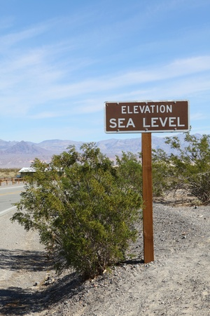 An elevation sea level sign on the road