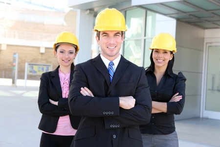 A handsome business man and woman construction team at office building Stock Photo - 9234551
