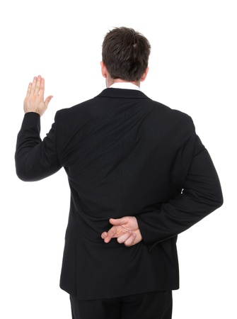 untruth: A business man lying while taking an oath Stock Photo
