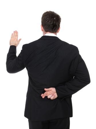 Un homme d'affaires couché tout en prenant un serment Banque d'images
