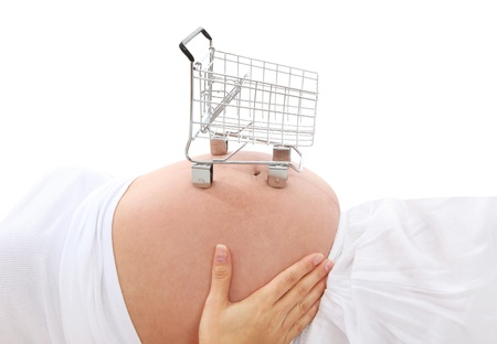 A pregnant woman with a small shopping cart on stomach
