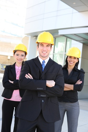 site manager: A handsome business man and woman construction team at office building