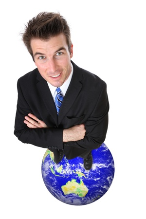 A business man celebrating global success standing on world