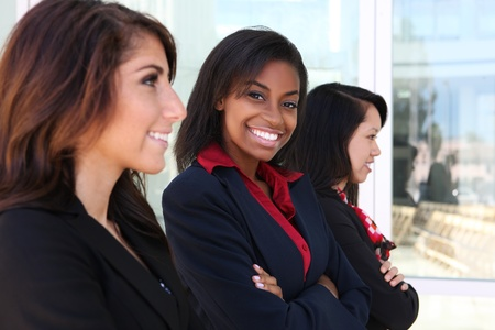 diverse: A diverse attractive woman business team at office building