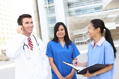 A successful man and woman medical team -doctor and nurse outside hospital photo