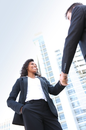 partnership power: A diverse attractive man and woman business team at office building