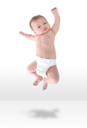A happy young baby infant jumping for joy Stock Photo