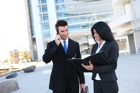 Ethnic man and woman business team at office building photo