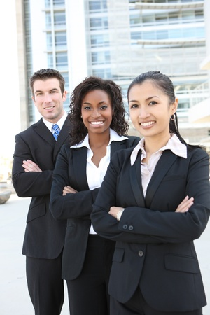 A diverse attractive man and woman business team (FOCUS ON MIDDLE WOMAN) photo