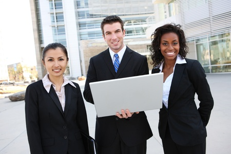 A diverse attractive man and woman business team at office building with computer photo