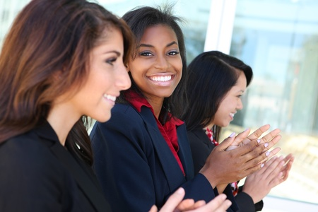 diverse people: A diverse business woman team clapping at presentation