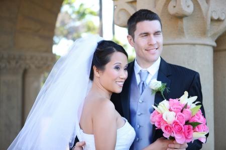 vőlegény: Bride and Groom at church Wedding with flowers (FOCUS ON BRIDE)  Stock fotó