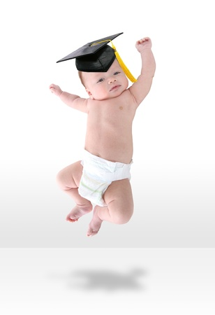 A happy young baby infant jumping for joy Standard-Bild