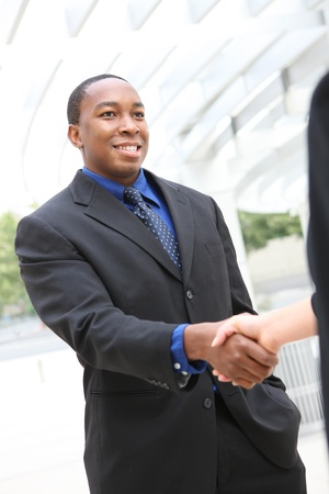 A handsome african american man handshake at office photo