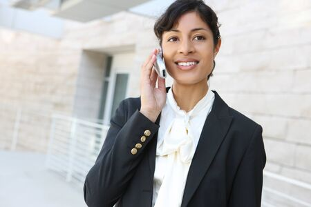 A pretty african american business woman at her office building on phone Stock Photo - 9711225