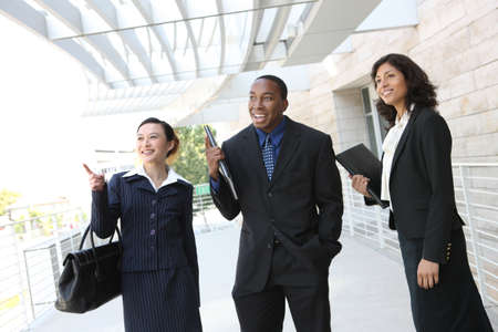 Diverse attractive business man and woman team at office building photo