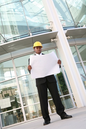 A young african american man working as an architect on a building site photo