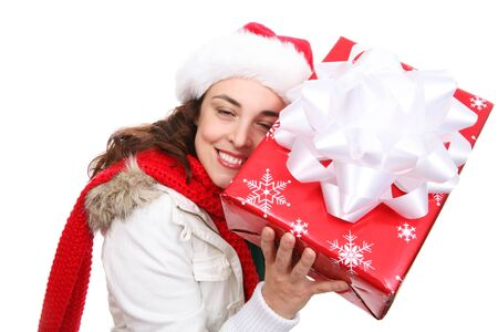 A young lady in a Santa hat guessing her Christmas present photo