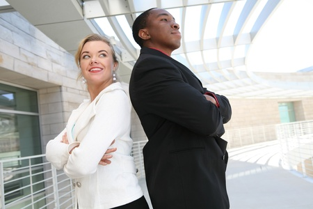 An attractive, diverse man and woman business team at the office building photo