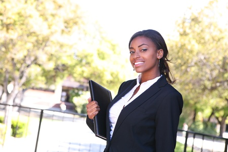 african student: A pretty woman teacher walking to class on the college campus Stock Photo