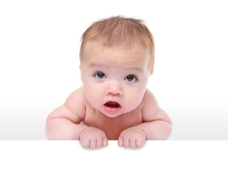 A cute young baby infant holding a sign over white background