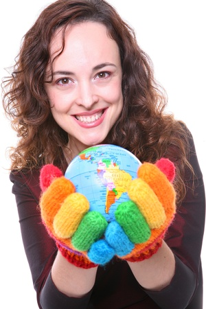 A woman with rainbow gloves holding a globe photo