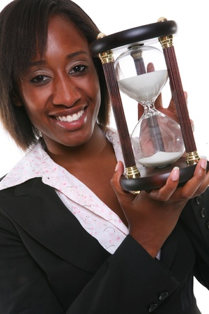 Young african business woman with hourglass - time concept
