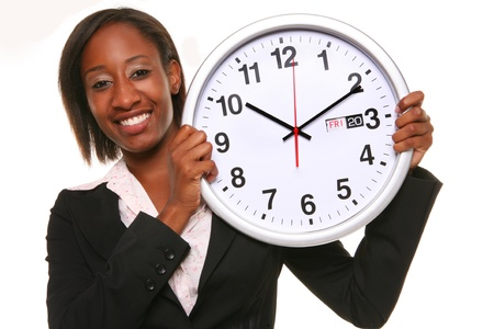 African girl with a big clock isolated on white background photo