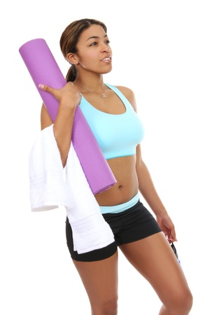 A pretty african american woman getting ready to exercise photo