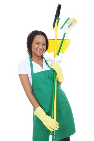 A pretty woman maid cleaner holding broom, pan, and mop