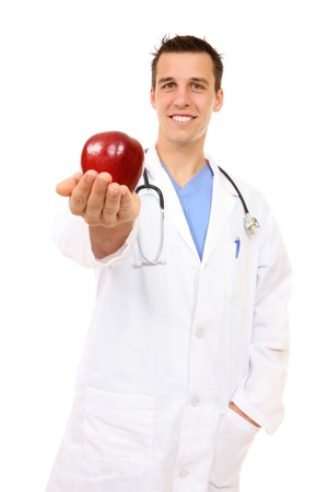 Handsome, happy smiling doctor with apple, isolated on white (Focus on Face) photo