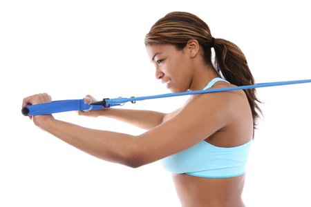sport wear: A pretty african american woman exercising isolated over white