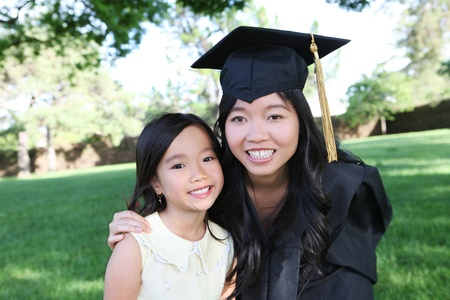 An asian mother and daughter celebrating a college graduation  photo