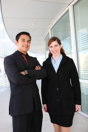 A man and woman business team at their company building  photo