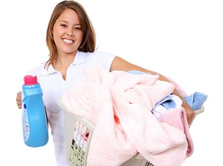 自宅で洗濯をしているかなり若い女性 写真素材